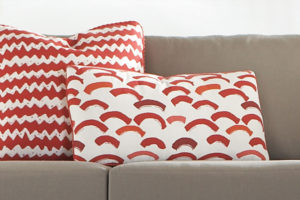 Printed red cushions on couch